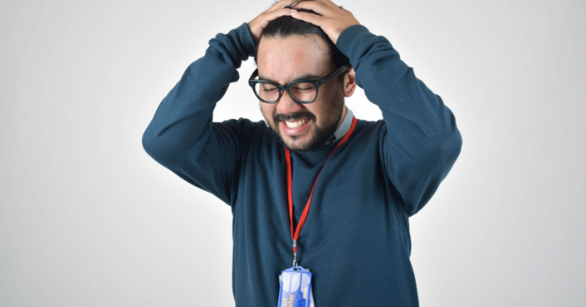 Anger in Men: photo of man who looks frustrated and is placing his hands on his head