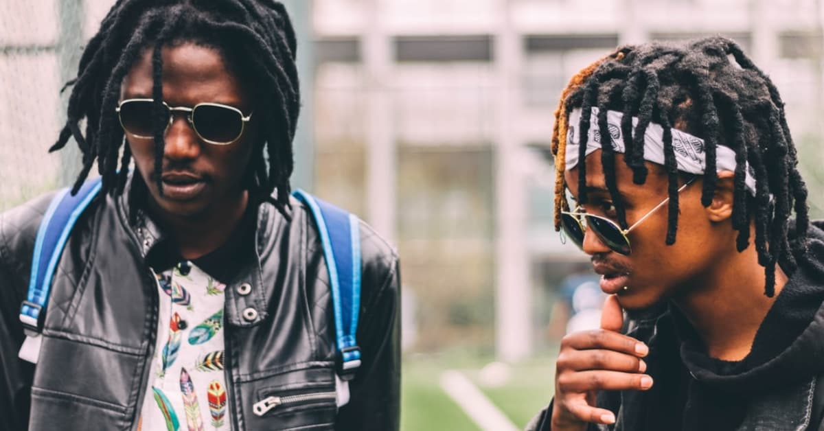 Young black men dressed in street fashion