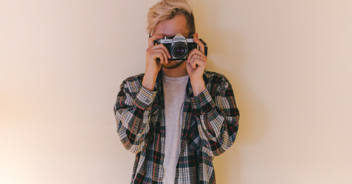 Man holding a camera in front of his face