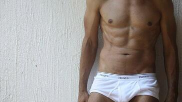 photo of muscular man in briefs