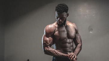 Muscular Black man flexing