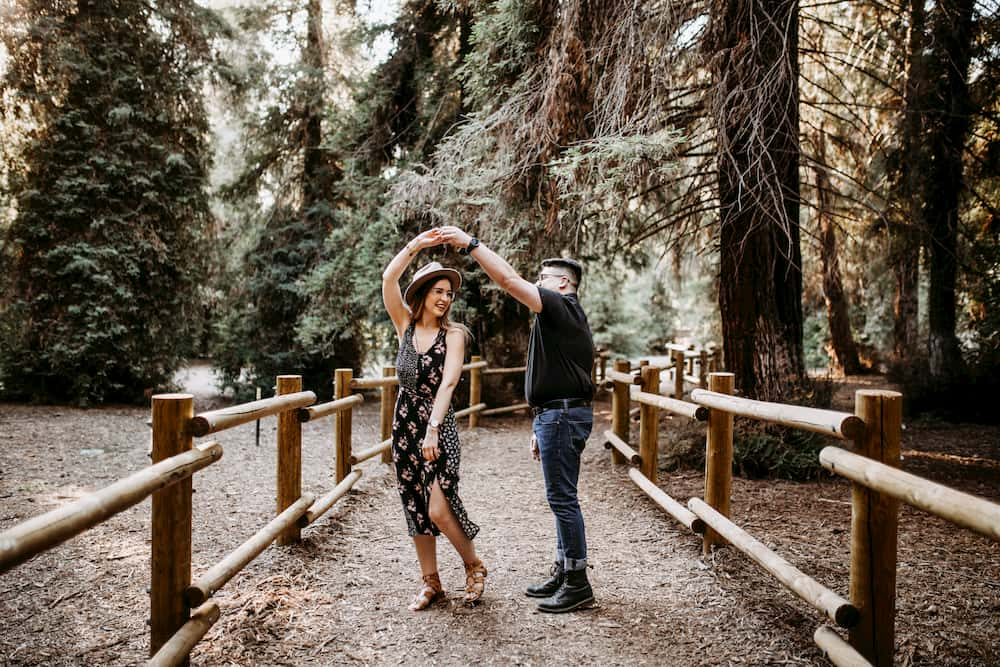 couple dancing on a trail in the woods