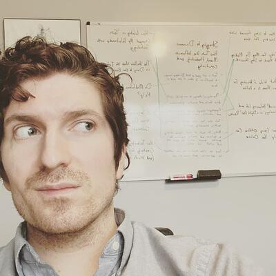 photo of blake with dry erase board in background