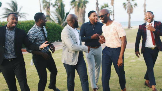 Group of black men smiling and laughing with each other