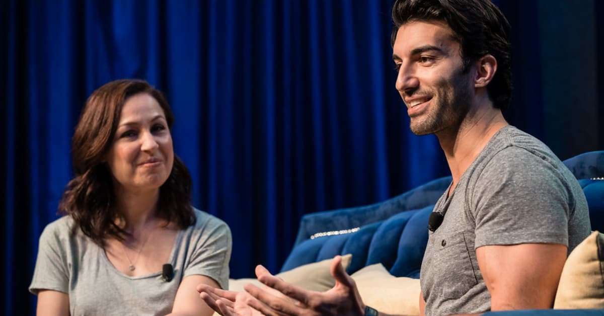 Justin Baldoni on stage for an interview