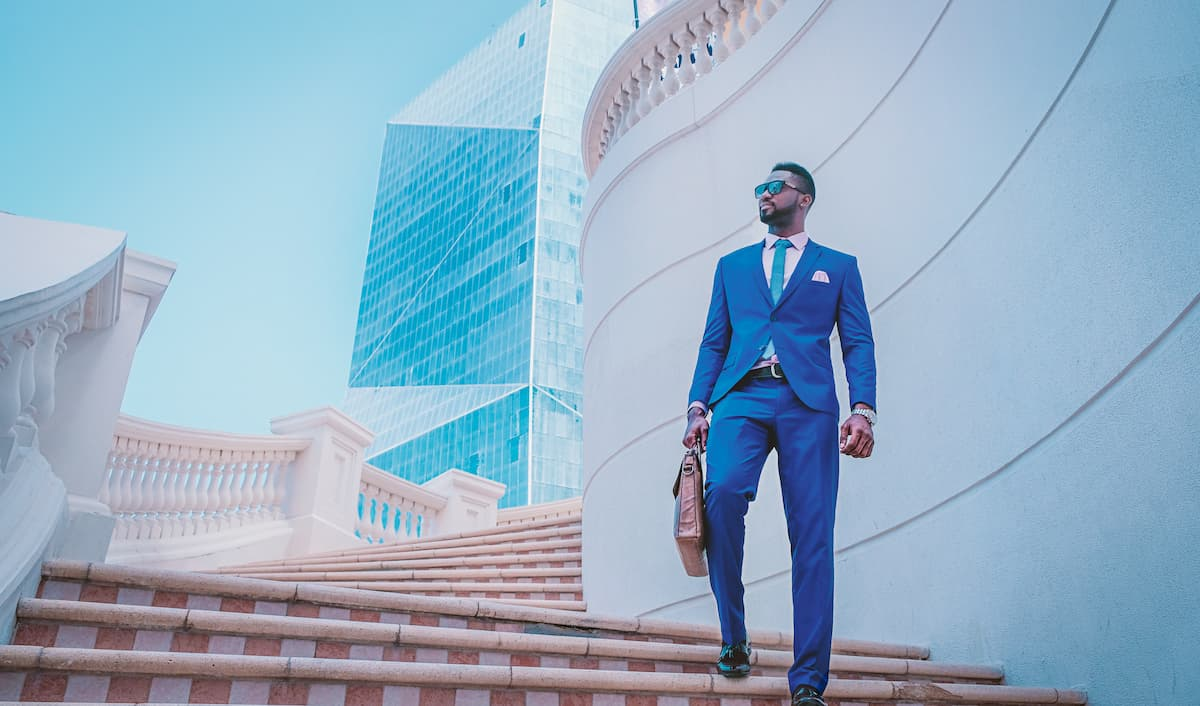 business man in blue suit descending stairs